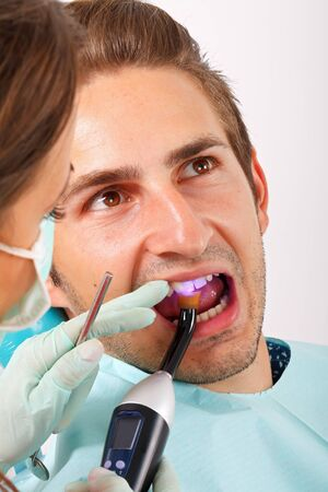 dental calculus: The dentist is filling the patients tooth