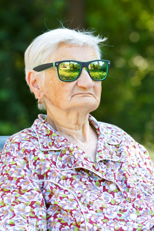 Picture of a funny senior woman wearing sunglasses