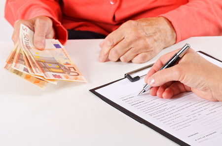 medical bills: Senior woman paying for her medical bills Stock Photo