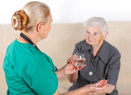 dementia: Female doctor helping a sick senior lady Stock Photo