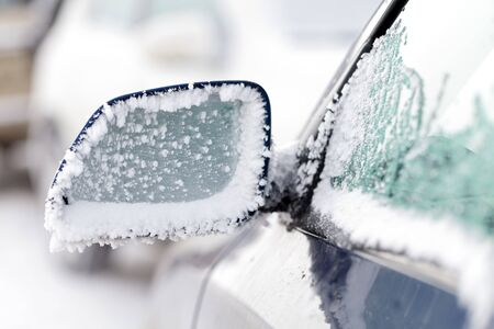 sleet: Picture of an iced car mirror and window