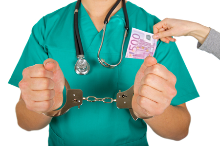 doctor money: Corrupt male doctor receiving money bribe Stock Photo