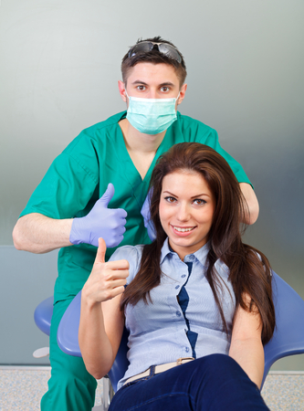 dental calculus: The dentist and the patient showing thumbs up