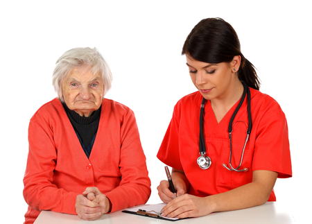 home health care: Picture of a senior woman with her caregiver