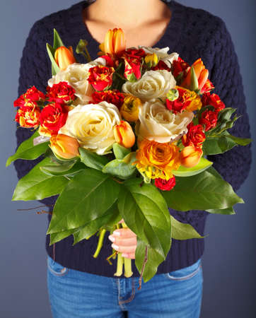 compliment: Photo of a woman holding a bouquet of flowers Stock Photo
