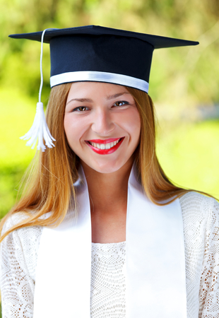 doctoral: Gorgeous happy young woman wearing graduation  hat