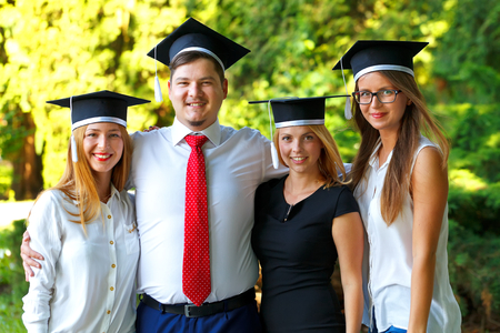 doctoral: Group of happy students enjoy their graduation day Stock Photo