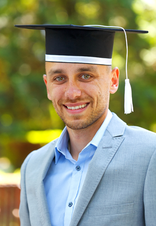 doctoral: Happy graduateing student wearing graduation  hat