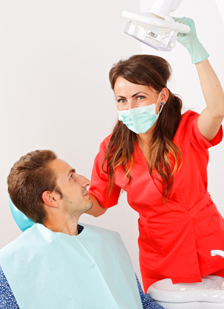 dental calculus: Female dentist is checking the patients mouth