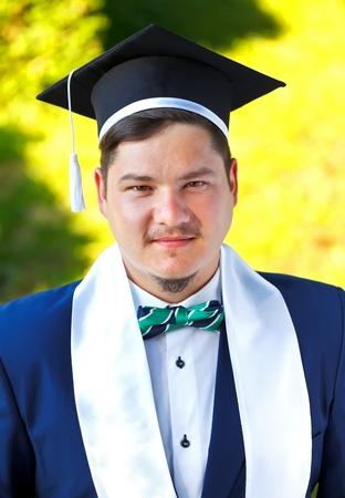 doctoral: Happy graduateing student wearing graduation  hat