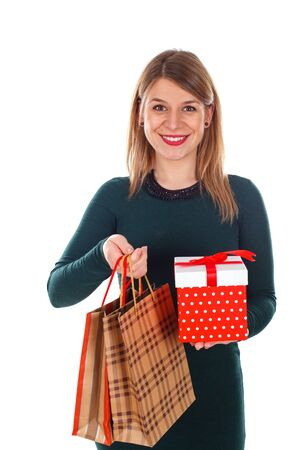 potrait: Potrait of a happy young woman holding Christmas gifts