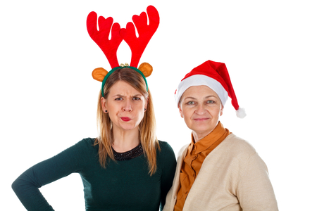 Picture of two happy ladies wearing Christmas costumes on an isolated background