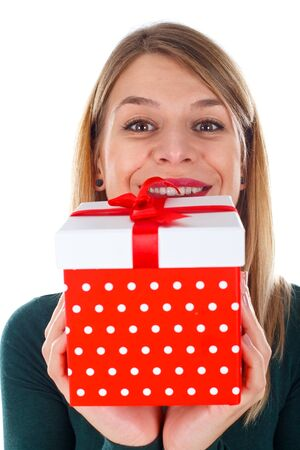 Picture of a happy woman holding a Christmas gift Stock Photo