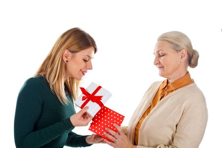 christmas spending: Picture of a beautiful young girl spending Christmas-time with her mother Stock Photo