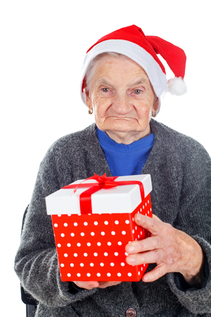 Picture of an elderly woman holding a Christmas gift
