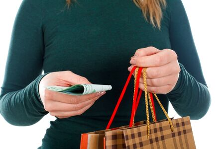 Close up picture of a woman holding a Christmas gift and money Stock Photo