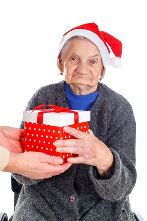 Picture of an elderly woman receiving a Christmas gift Stock Photo