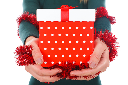 Close-up picture of a womans hands holding Christmas gift