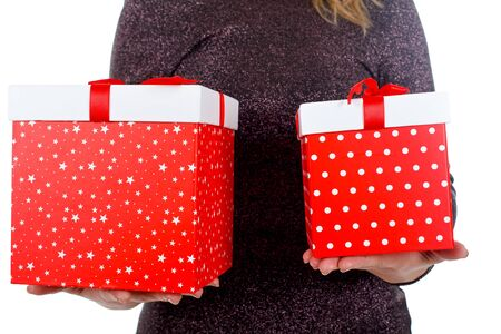 Close up photo of a young woman holding two Christmas boxes Stock Photo