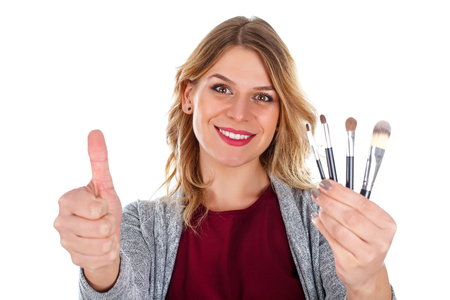 Picture of a beautiful make-up artist showing thumbs up