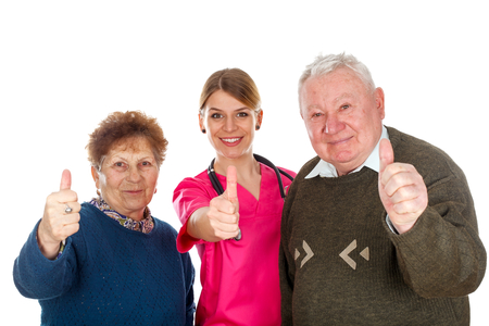 Picture of an aging couple and their assistant showing thumbs up