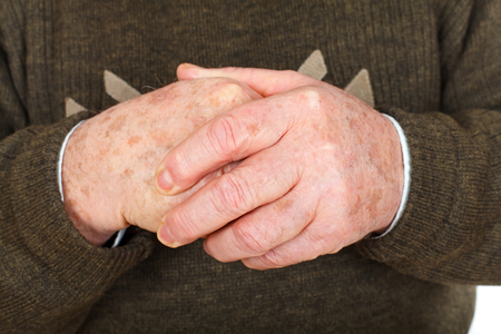 Close up picture of a senior mans hands