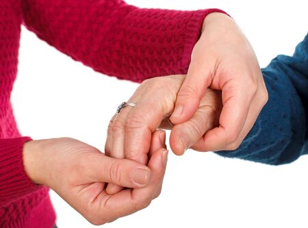 womens hands: Close up picture of two womens hands - grandmother with granddaughter Stock Photo
