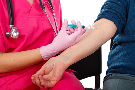 Close up picture of an elderly woman receiving an injection. Everything sterilized Stock Photo