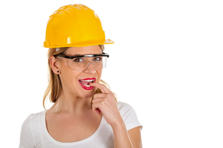 casque: Picture of a sexy young woman wearing a yellow helmet - isolated background