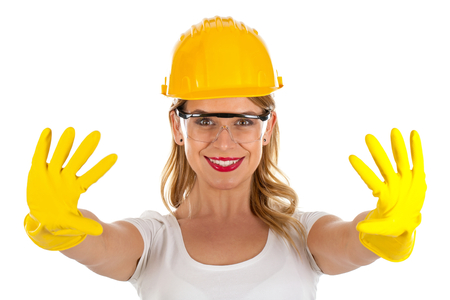 claw hammer: Picture of a sexy confident female engineer showing her hands