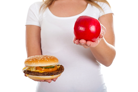 Close up picture of a delicious hamburger in a womans hands Stock Photo
