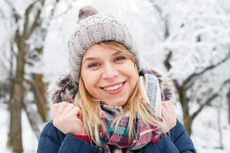 ifestyle: Picture of a young woman being cold outside on wintertime