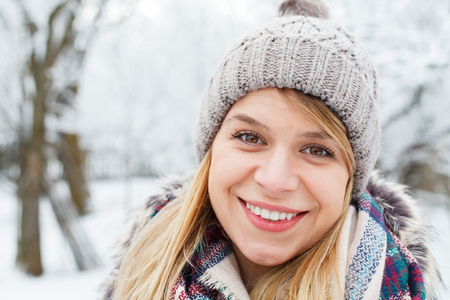 ifestyle: Portrait of a happy young girl on wintertime Stock Photo