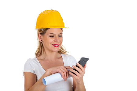 Picture of a beautiful female engineer sending a text message