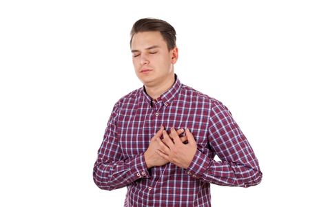 premature: Picture of a young man having a serious chest pain