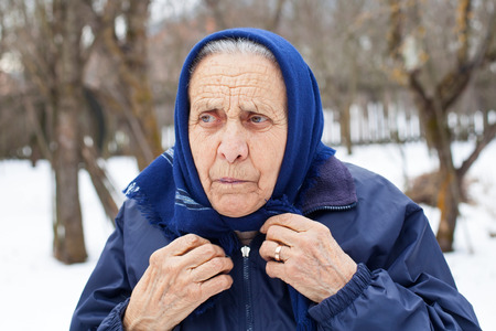 Picture of an angry elderly woman posing outdoor