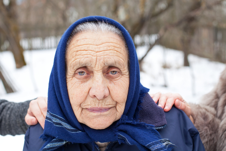 Picture of an elderly woman with her caretakers outdoor Stock Photo