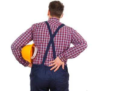 dorsalgia: Picture of a young male engineer having a serious backpain