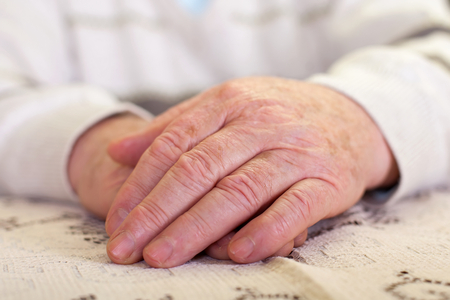 Close up picture of elderly mans hands
