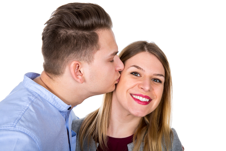 Picture of a romantic young guy kissing his beautiful girlfriend