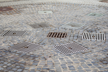Close up picture of a drains in the middle of a romanian city