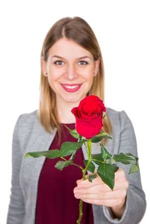 to confess love: Picture of a beautiful young woman holding a red rose
