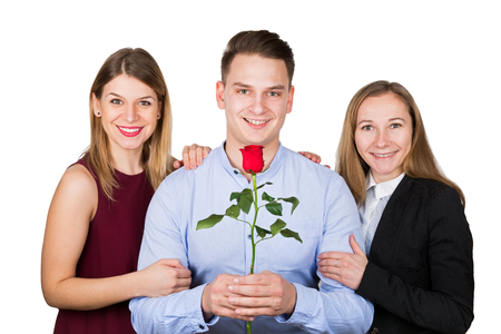 Picture of a young man posing with two beautiful woman, bigamy