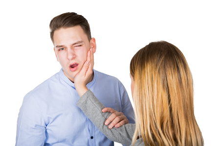 Picture of a frustrated young couple having a fight on isolated background Stock Photo