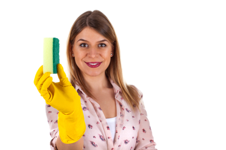 Picture of a beautiful young lady holding a cleaning sponge on isolated background Stock Photo