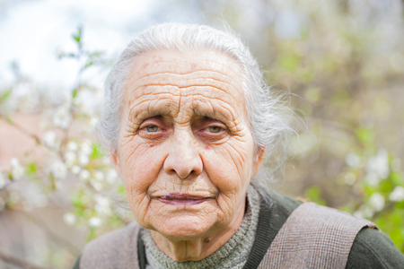 expressive face: Picture of a retired elderly woman outdoor
