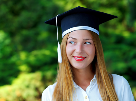 Gorgeous happy young woman wearing graduation  hat