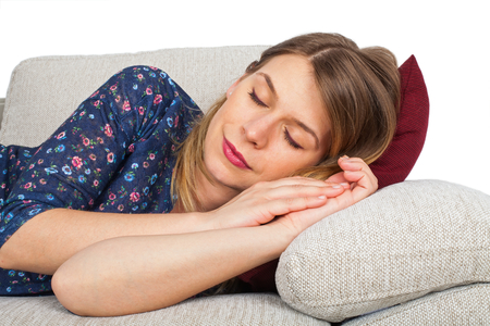 exhausting: Picture of an attractive young woman lying on the couch at home having a headache