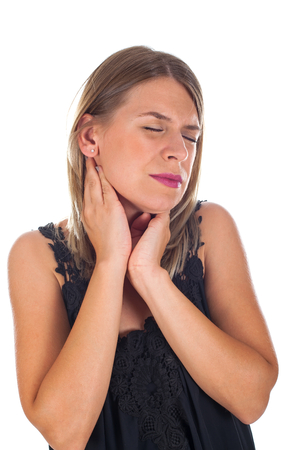 Picture of young woman having sore throat holding her neck, checking the inflamed glands - isolated background