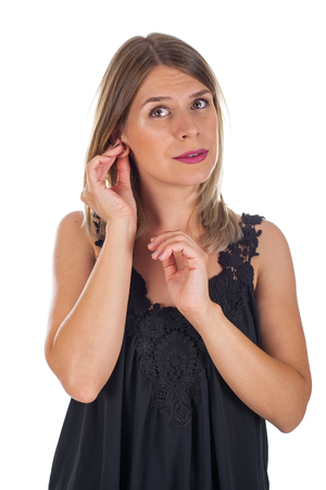 Young woman holding her ear, having a strange ache, Menieres syndrome on isolated background